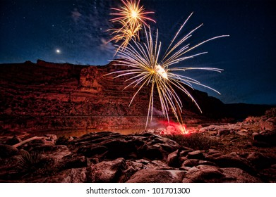 Fireworks arcing over river and canyon, Planet in background