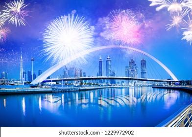 fireworks around Tolerance bridge - exotic New Year destination, Dubai, UAE