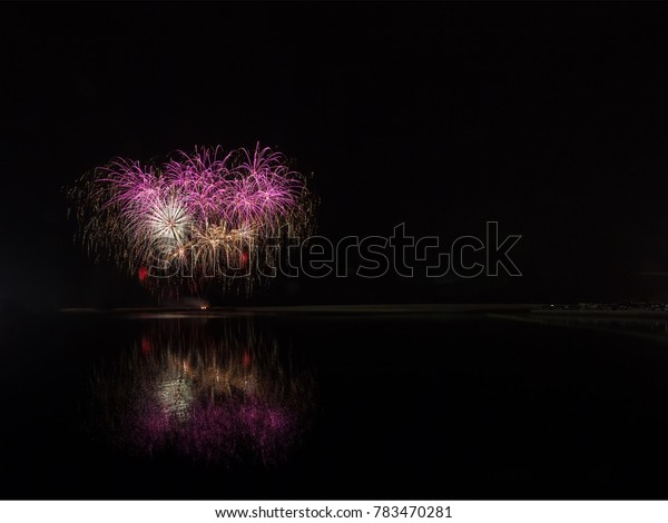 Fireworks - Art of Fireworks - Night Sky brightened by colorful firework display.