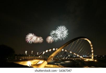 Fireworks are being displayed over Putrajaya dam in Putrajaya, Malaysia.