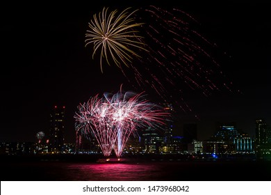 Fireworks being set off from the River Mersey lighting up the skyline of Liverpool - captured on bonfire night from Seacombe on the Wirral Peninsula.