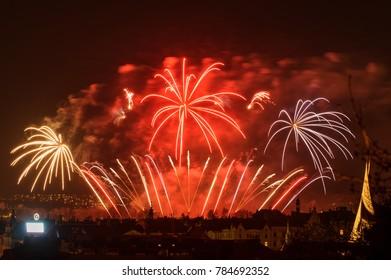 Fireworks. Big sparkles above night city.