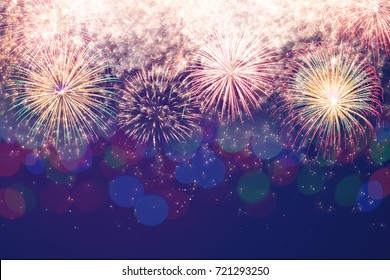 Fireworks and bokeh in New Year eve with copy space. Abstract holiday background