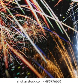 Fireworks in bright colors of pink green blue red and green celebrating New Years or Independence Day abstract background blur