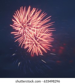 fireworks of bright red against the blue black sky