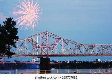 Fireworks by Ohio River by Kentucky/Indiana border bridge on Ohio River