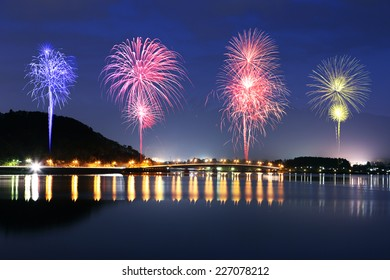 Fireworks celebrating over Lake Kawaguchiko at night with mount Fuji background, Japan