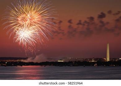 Fireworks celebration over the Washington skyline with Washington Monument visible.