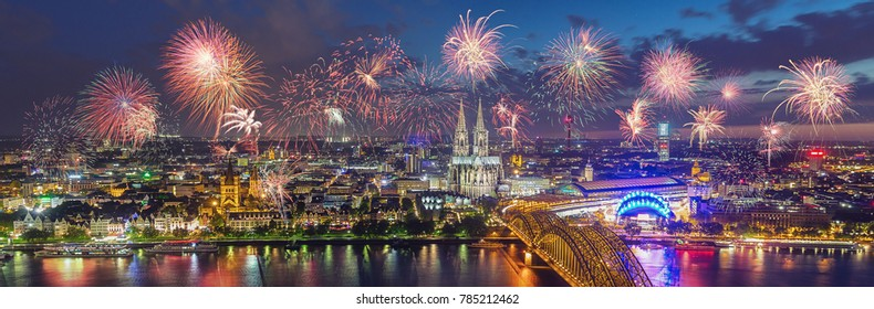 Fireworks at Cologne Skyline with Cathedral and Hohenzollern Bridge, Cologne, Germany