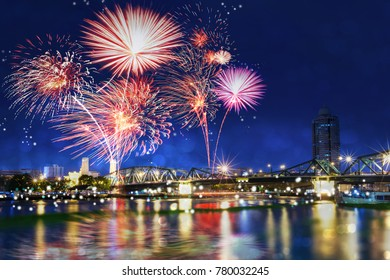 Fireworks countdown celebration in the sky over Krung Thon Bridge Pier or Sang Hee, Thonburi, Chao Phraya river, view from Bankgkok side  Thailand