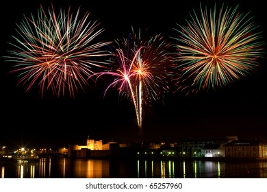Fireworks display above King Johns Castle and the river Shannon, Limerick City Ireland.