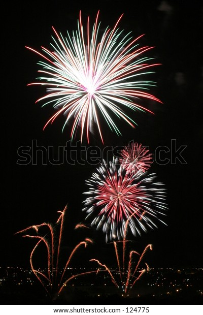 Fireworks display, including the lights of the suburbs on the horizon...