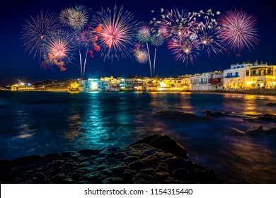 Fireworks display at Little Venice district of Mykonos island at night. Greece