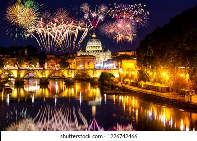 Fireworks display near Sant' Angelo Bridge and St. Peter's cathedral in Vatican City, Rome.Italy