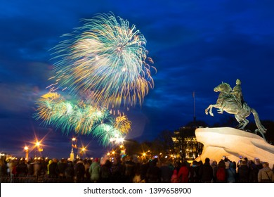 Fireworks in the evening sky near the historical monument of 1782 to Tsar Peter the Great - The Bronze Horseman in St. Petersburg in Russia.