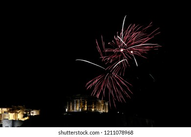 Fireworks explode above the ancient Parthenon temple atop the Acropolis hill during New Year celebrations in Athens on January 1, 2016