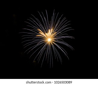Fireworks explode on an isolated black background