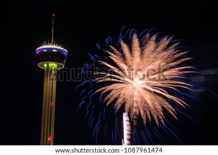 Fireworks explode very close to a tower during the opening celebration of Fiesta San Antonio in San Antonio Texas.