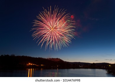 Fireworks Exploding Over a Mountain Lake.