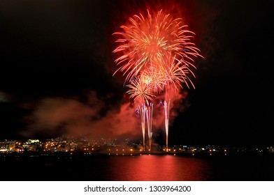 Fireworks explored in the sky at night in sea port of Hakodate during summer,hokkaido,Japan.