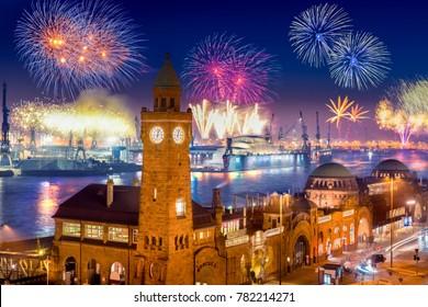"Fireworks in Hamburg Harbor, Germany, at the pier ""Landungsbrücken""."