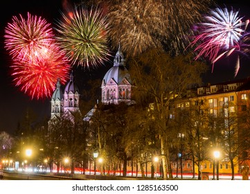 Fireworks at the  illuminated Sankt Lukas church in Munich at night