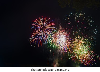Fireworks light up the sky with dazzling display. Slightly soft focus due to Slow Shutterspeed
