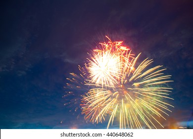 Fireworks light up the sky with dazzling display. Fireworks display on dark sky background. Independence Day, 4th of July, Fourth of July or New Year.