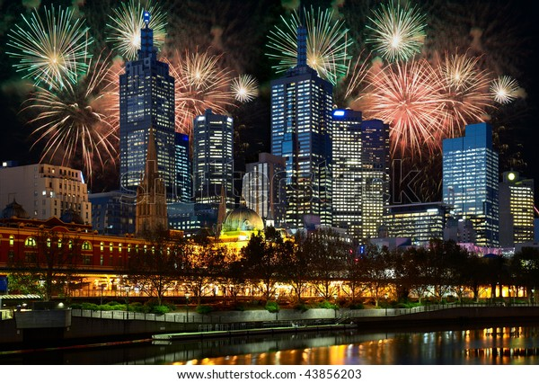Fireworks and night illumination in center of Melbourne city