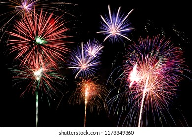 Fireworks in the night sky. Bright colors. Big explosions.