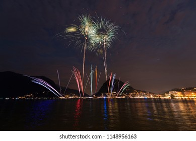 Fireworks on the lakefront of Lugano in summer evening, Switzerland