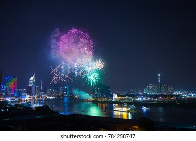 Fireworks on the riverside - celebration of the New Year in Ho Chi Minh city (Sai Gon), Vietnam. Saigon skyline aerial with firework view.