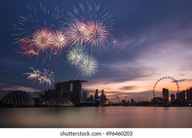 Fireworks over bay ,Silhouette building during sunset and sky twilight at Singapore on National day rehearsal