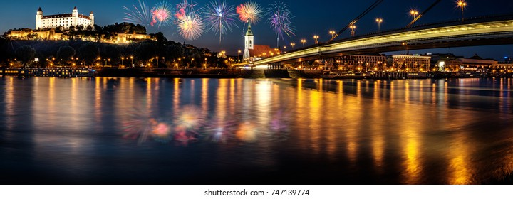 Fireworks over Bratislava castle,Parliament and the New bridge over Danube river with evening lights in capital city of Slovakia,Bratislava