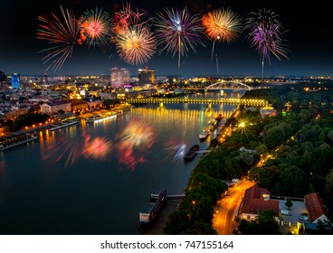 Fireworks over Bratislava, Danube river with evening lights in capital city of Slovakia,Bratislava