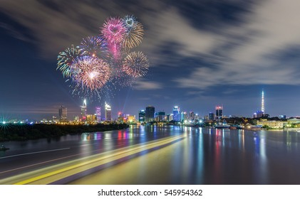Fireworks over Business and Administrative Center with almost financial towers of Ho Chi Minh city by night, view from Thu Thiem Bridge.