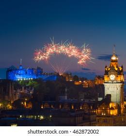 Fireworks over Castle and Balmoral Clock Tower during The Edinburgh International Festival aka The Fringe, Scotland, UK.