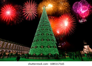 Fireworks over Christmas tree on Commerce square at night in Lisbon, Portugal