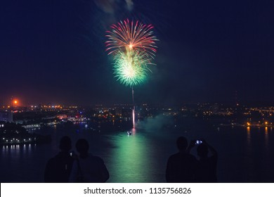 Fireworks over a city at night.