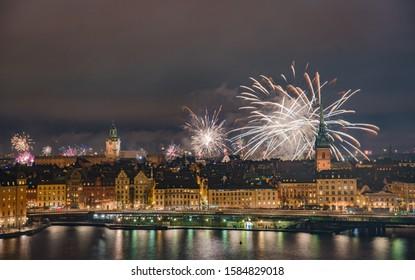 Fireworks over city skyline on New Year Night. Stockholm, Sweden.