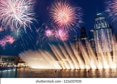 Fireworks over Dubai mall fountain show at night