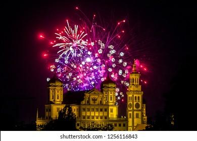 fireworks over the illuminated Augsburg Town Hall