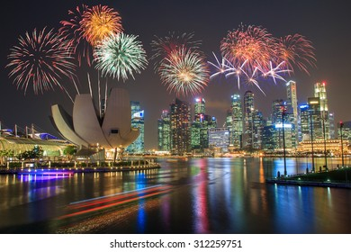 Fireworks over Marina bay in Singapore on national day fireworks celebration