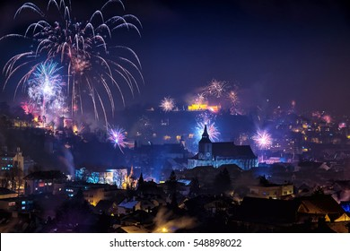 Fireworks over medieval city of Brasov, Romania