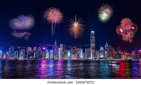 Fireworks over the night Hong Kong. Amazing panoramic city skyline view.