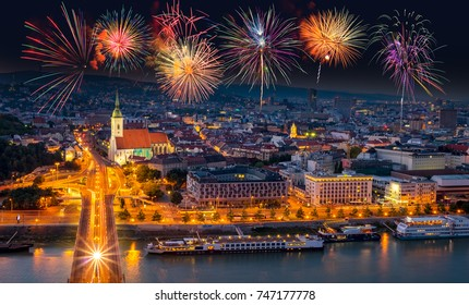 Fireworks over the Old Town in Bratislava, new bridge over Danube river with evening lights in capital city of Slovakia,Bratislava