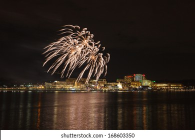 Fireworks over the Potomac River in Price George's County, Maryland south of Washington, DC at night in the harbor.