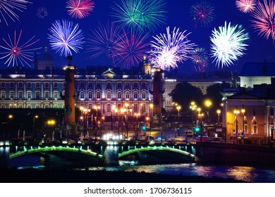 Fireworks over Rostralnaya Kolonna or column on Neva river and Winter Palace, Zimnij dvorets in Saint Petersburg, Russia - Shutterstock ID 1706736115