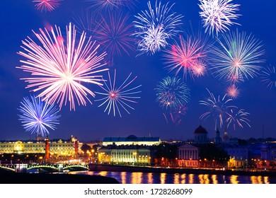 Fireworks over Saint Petersburg downtown Rostralnaya Column, Neva river embarkment, Winter Palace, Russia