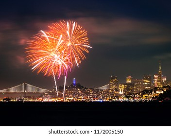 Fireworks over San Francisco on Fourth of July with Coit Tower Bay Bridge and Transamerica Pyramid in frame